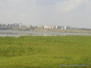 Северный, Порожнеча, река и камыши.
